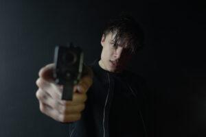teenage with a gun
