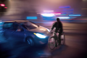 car will hit the guy in bicycle