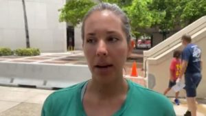 protester speaks to Local 10 News